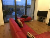 Red leather L sofa and footstool = sofabed