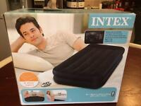 Intex super wide single air bed with built in pump (brand new & unopened)