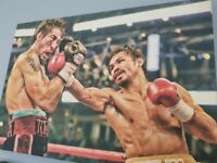 Two boxing canvases. Manny Pacquiao and Rocky Balboa.