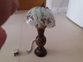 Carved wood lamp with glass shade
