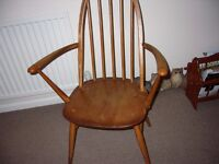 Pair of 1950s Ercol carver dining chairs.