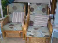 Two conservatory chairs both same pattern one is only 2yrs old