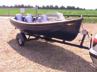 Very pretty 4-person electric river launch with road trailer
