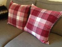 Pair of large red tartan/check cushions