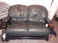 Green leather two seater sofa FREE