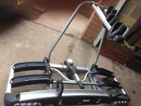 Thule car bike rack for 3 bikes. Sits on towing hitch. Lockable, Used but in good condition,