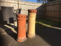 2 chimney pots with chimney cowls