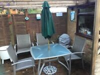 Patio set - glass top table, four chairs , parasol & base