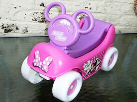 Pull along car Minnie Mouse. Music and phrases