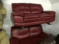 2 red leather 2 seater sofa