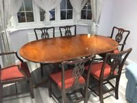 Extended solid wood table with 6 chairs