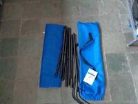 Blue folding camp bed