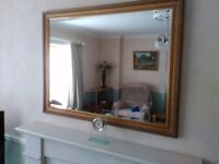 Large mirror for sale - 113cm x 88cm with gold coloured wooden frame. £25:00 - collected