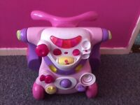 Baby walker converts to sit on and push along like new