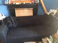 Black sofa with 2 black cushions