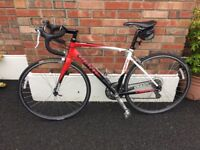 Giant road bike and rollers for sale,Bike hardly ever used,first to see will buy