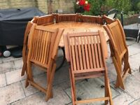 Octagon hard wood table with 8 chairs including drinks trolley
