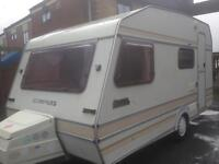 4 berth Compass omega. 2 awnings and extras. Lightweight good condition for age