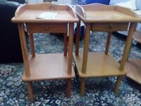 Two bedside wooden tables.