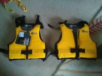 Two csr bouyancy aids yellow and black med/large
