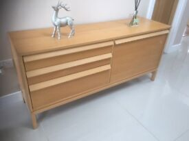 A LOVELY MODERN BEECH SIDEBOARD THREE DRAWS AND PULL DOWN DOOR IN GOOD CONDITION £45 ONO