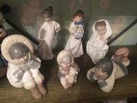 Collection of 7 Nao and 1 Lladro