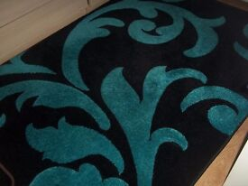 for sale blue and black rug.