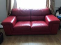 beautiful 2 seater red italian sofas x 2. Like new.