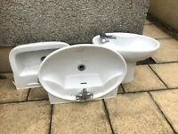 2 Bathroom Basins with taps and legs and a bidet with tap