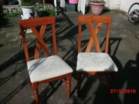 round drop leaf dining table and two chairs.