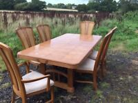 Extendable oak table and 6 chairs.