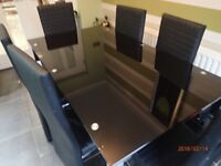 Tempered black Glass Kitchen/dining room table with 6 chairs .