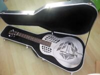 Tricone Resonator Guitar. Vintage make, upgraded with National cones and a Highlander pickup.