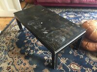 Black and gold OKA coffee table with Chinese pattern