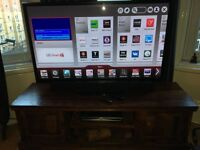 50 inch LG HD-ready plasma smart TV + sound bar and stand
