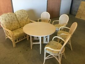 Cane conservatory set including table, chairs and sofa