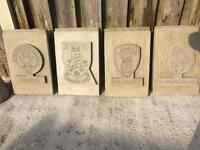 Stone football plaques