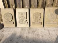 Stone football plaques