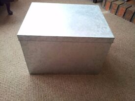 Metal storage box.