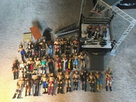 Collection of 35 WWE Mattel Basic Figures, Accessories & Slam 'N Launch Deluxe Wrestling Ring