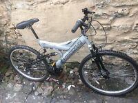 Shockwave 500 gents dual suspension mountain bike 18 gears 19 inch frame 26 inch wheels