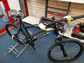 BRAND NEW BTWIN ROCKRIDER 340 MOUNTAIN BIKE, NEVER BEEN RIDDEN , WITH LABELS AND BAGGED ATTACHMENTS