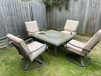 Garden table and chairs set with fire pit/ice bucket in middle of table