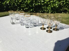 Assorted vintage glassware with gold rims.