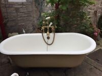 Original French roll top cast iron bath with original brass taps & shower head