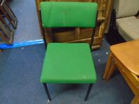 green textile and metal chair