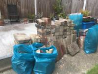 Load of bricks, hard core etc. And three bags of builders sand