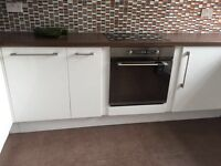 Induction hob, oven and extractor hood