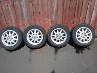 4 X 15 INCH BMW ALLOY WHEELS WITH NEARLY NEW MATCHING TYRES