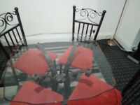 Black marble affect cast iron glass table and 4 chairs